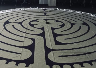 photo of a canvas labyrinth on the floor