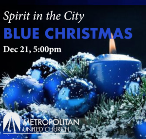 photo of blue christmas decorations and a light blue candle