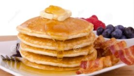 picture of a stack of pancakes and fruit