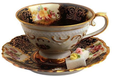 a fancy teacup and saucer