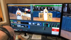 monitor view of minister and online worship service