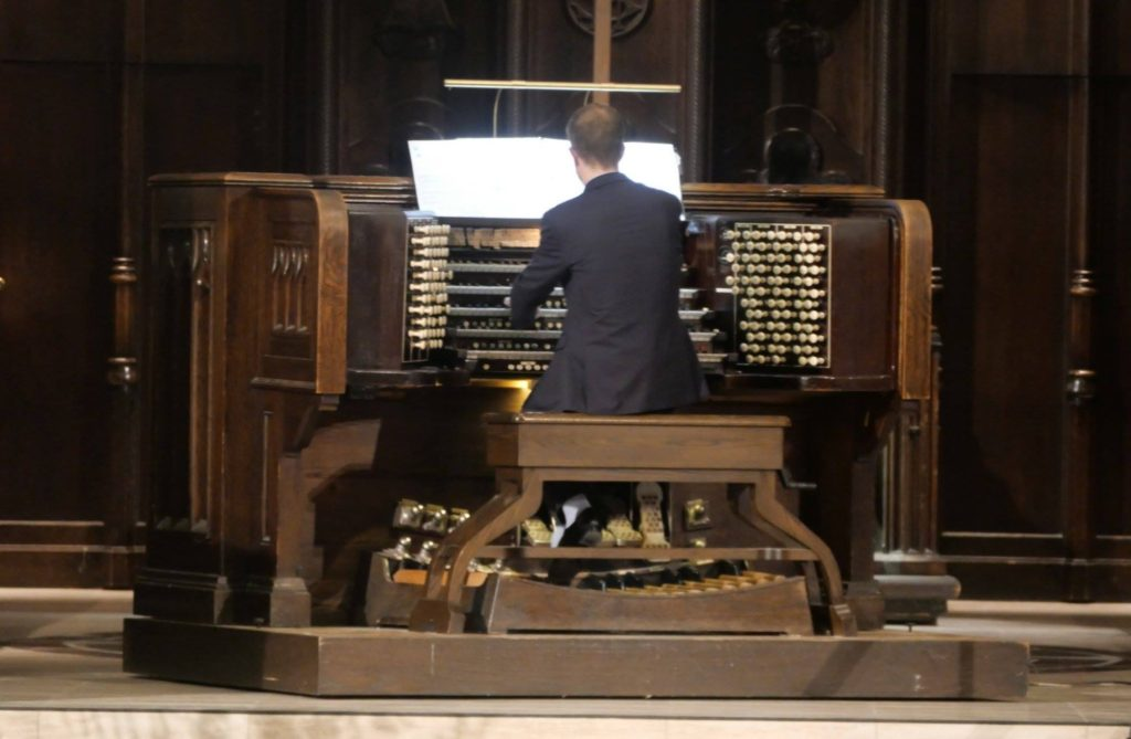 Musician playing the organ in a church