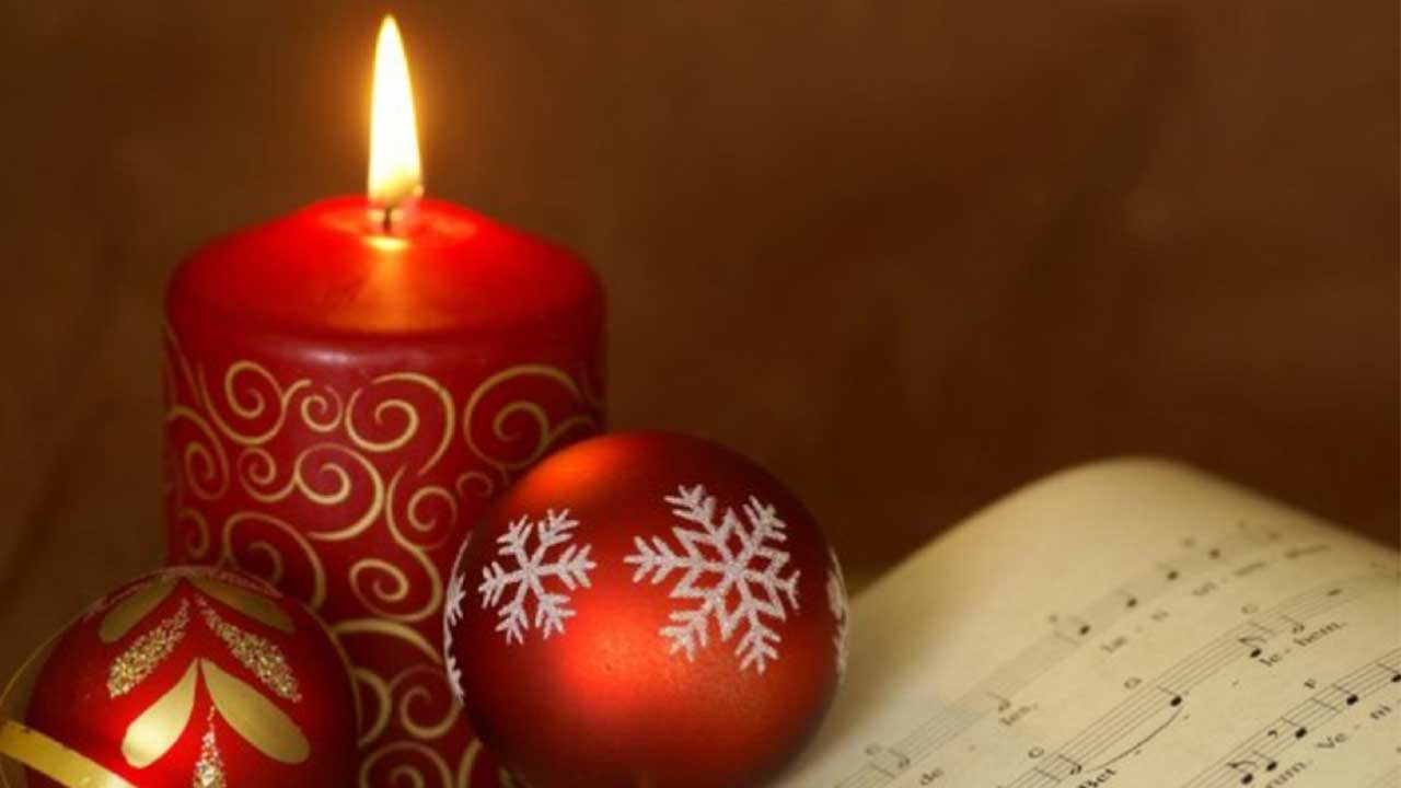 red ornaments, candle with sheet music