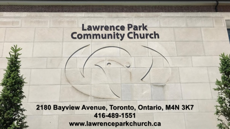 recessed carved dove symbol on a concrete church wall