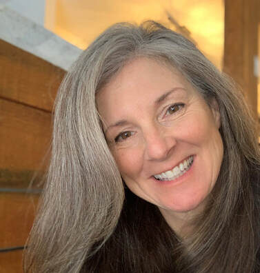 headshot of Suzanne Whitt Foley