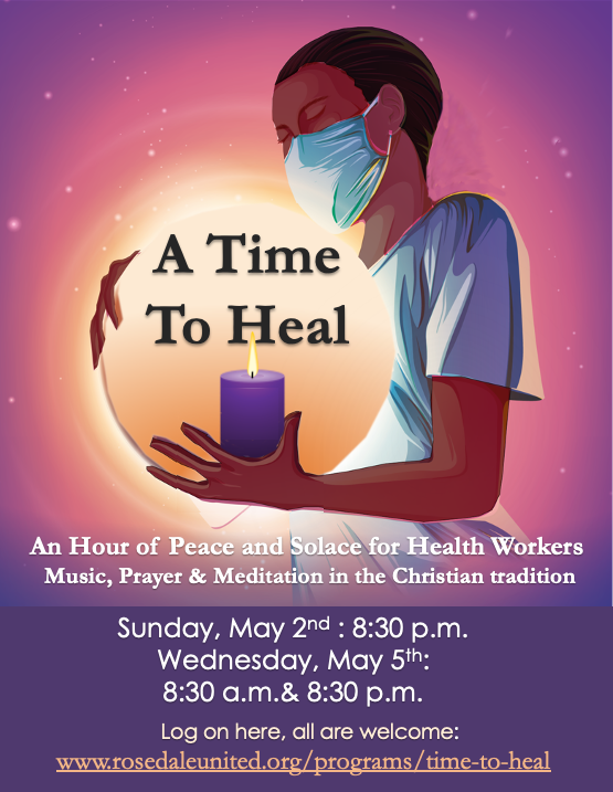 a healthcare worker in a mask, holding a candle