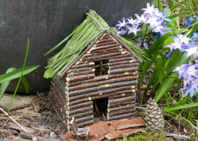 fairy house from twigs on the ground