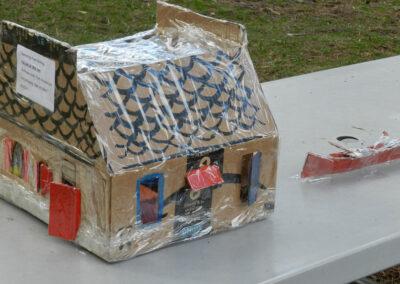 house and canoe made of cardboard