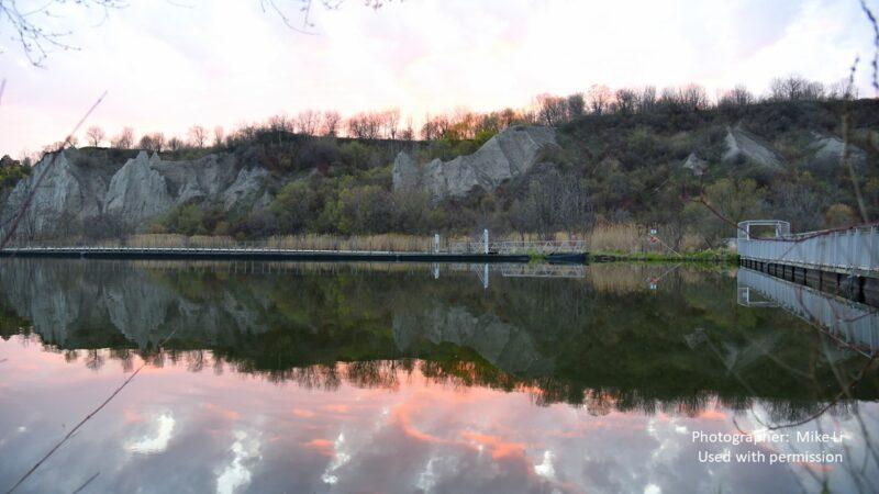 reflection of a lakeshore at dawn