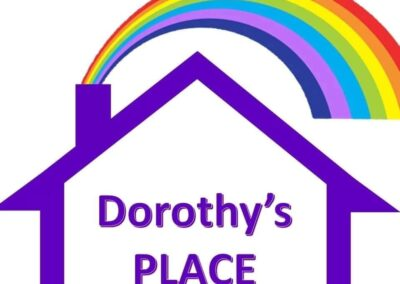 Dorothy's place logo: purple house with a rainbow above