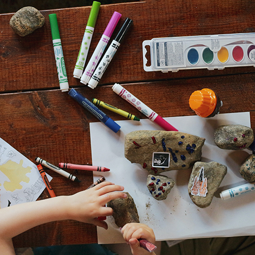 kid doing rock painting and crafts