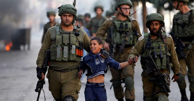 photo of soldiers with a young child